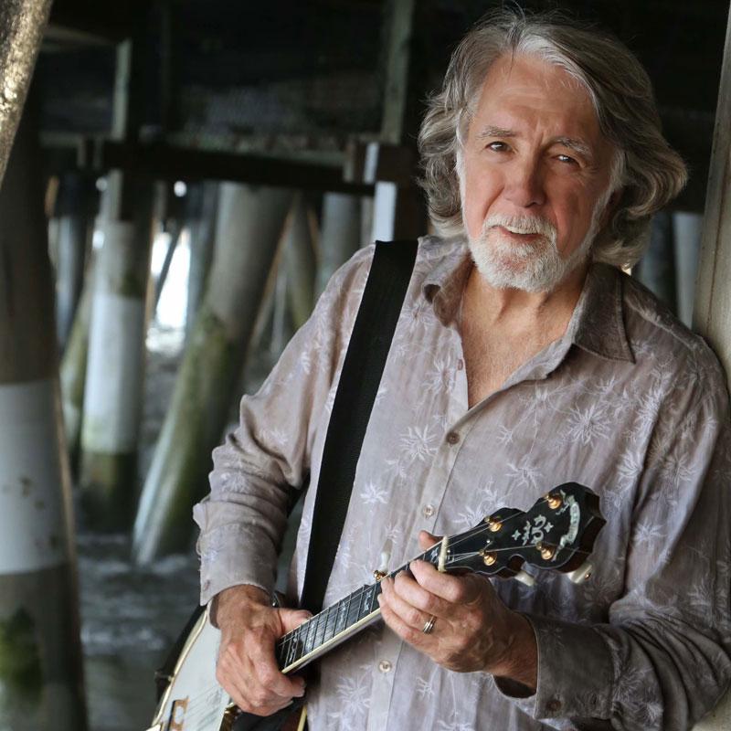 John McEuen holding a banjo